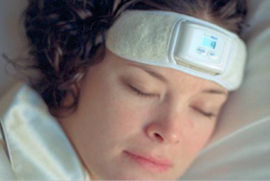 Woman wearing SleepGuard biofeedback headband while sleeping
